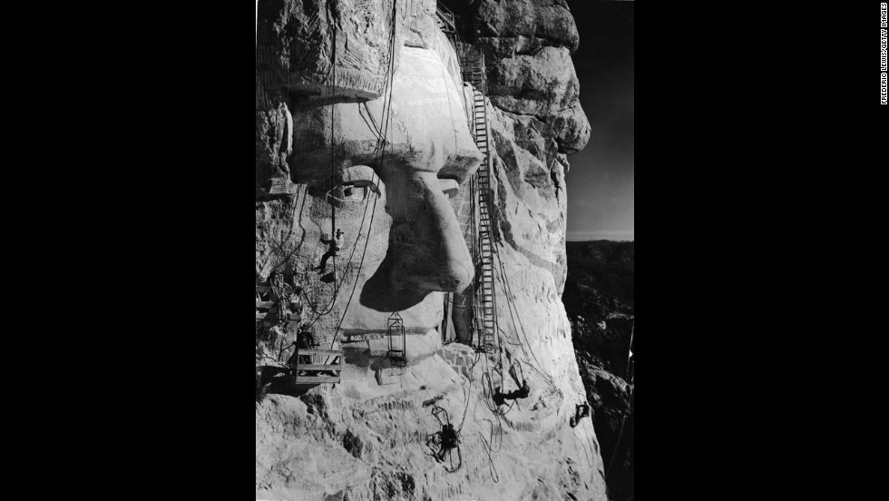 In 1927, American sculptor Gutzon Borglum began work on carving Mount Rushmore in Keystone, South Dakota. Borglum is pictured here -- along with several members of his crew in the 1930s -- below the eye of President Abraham Lincoln.