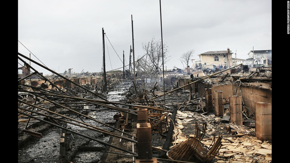 Debris and destroyed homes line a street in the  Breezy Point neighborhood of Queens, New York, on October 30, 2012.