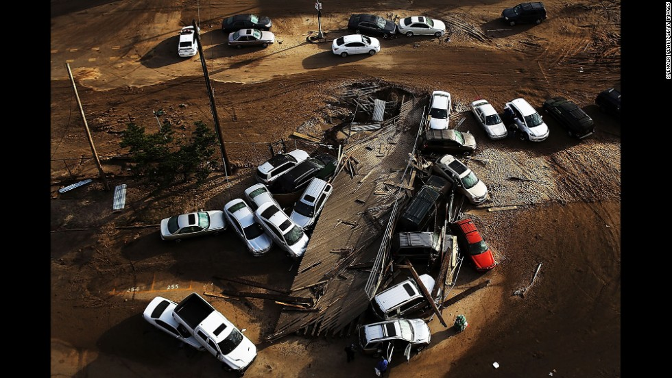 Abandoned and flooded cars are scattered in the Rockaway neighborhood of Queens on November 2, 2012.