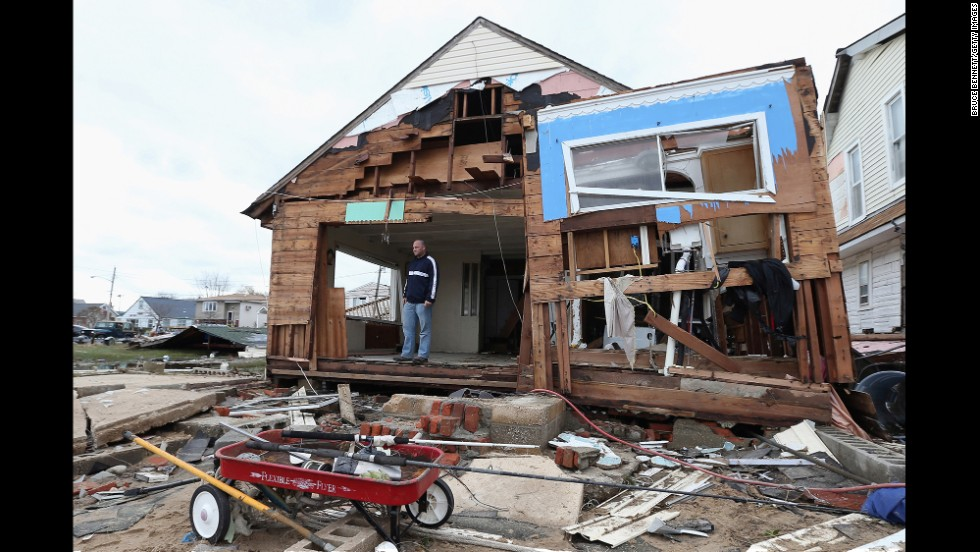 Gary Silberman surveys his destroyed home on October 31, 2012, in Lindenhurst, New York,