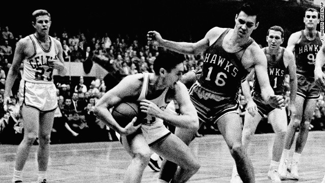 Bill Sharman draws coverage from St. Louis Hawks' Cliff Hagan during a March 30, 1958 game in Boston.