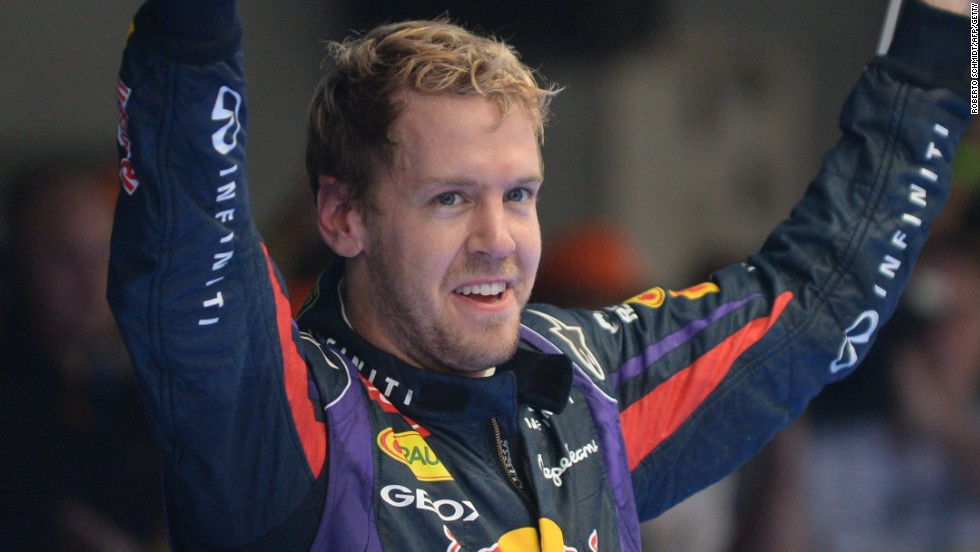 Sebastian Vettel celebrates victory at the Indian Grand Prix in October. The win clinched a fourth straight F1 world title.