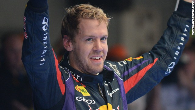 Sebastian Vettel celebrates his Indian Grand Prix victory to clinch his fourth straight F1 world title.