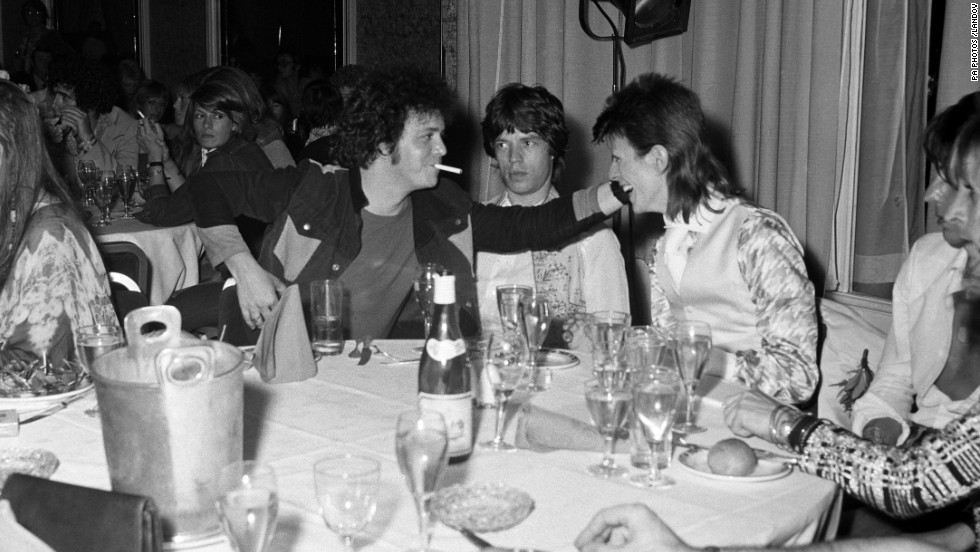Reed, Mick Jagger, center, and David Bowie, right, share a joke at a party at Cafe Royal thrown by Bowie on July 3, 1973.