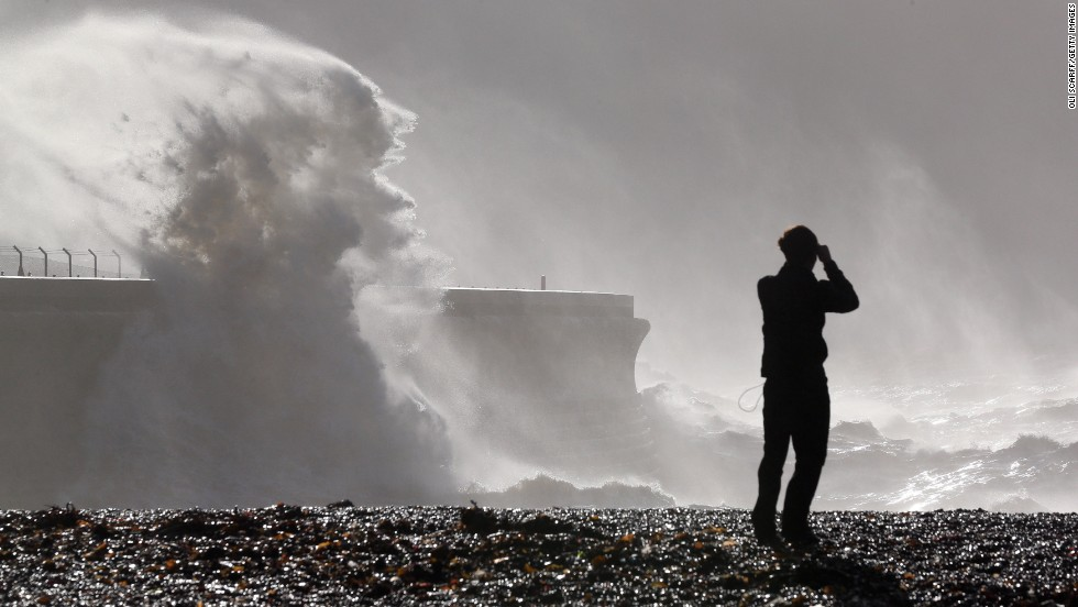 Large waves break against the harbor wall in Dover, England, on Monday.