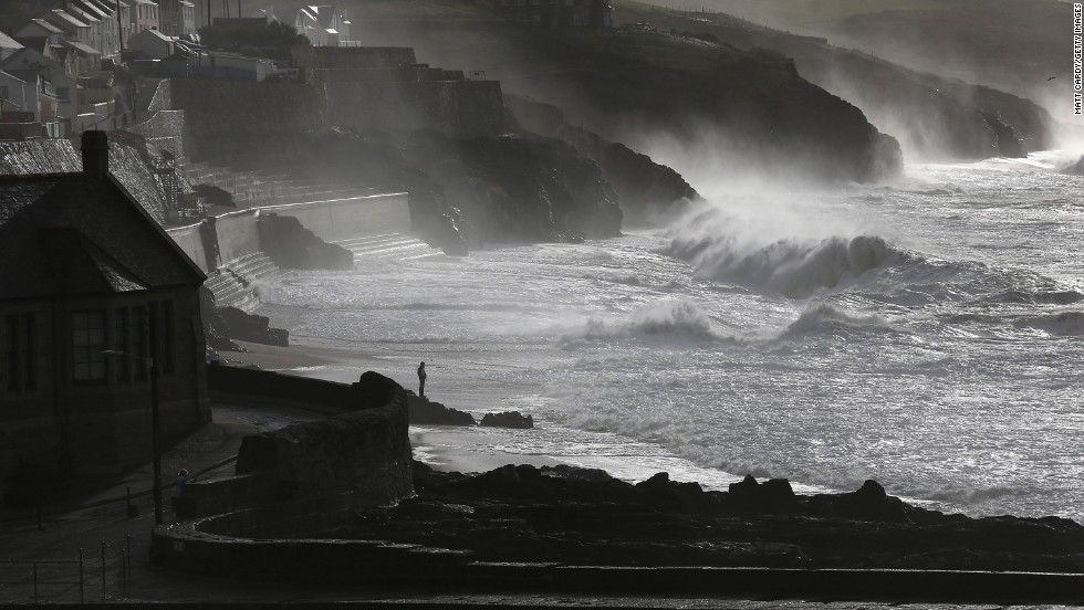 Large waves break along the coast in Porthleven, England, on Monday.