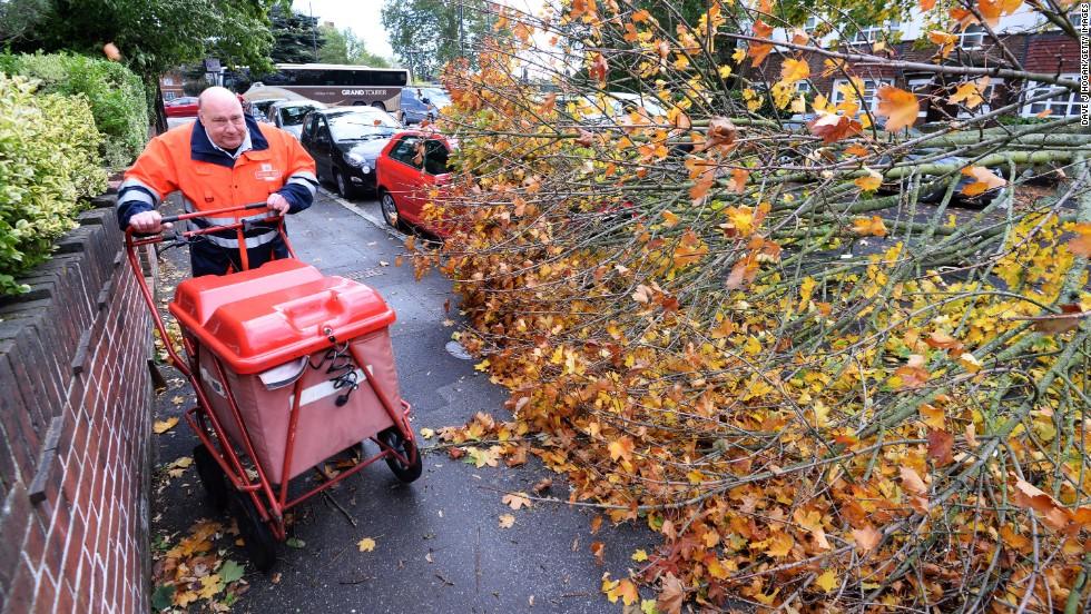 A fallen tree lies on a London road Monday.
