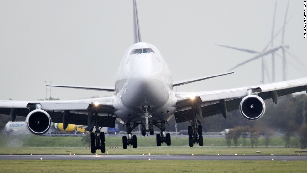 A plane lands with a tilted angle Monday on the runway of Amsterdam Schiphol Airport.