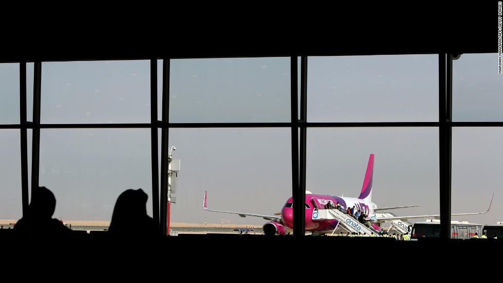 Passengers disembark from low cost Hungarian carrier Wizz Air -- the first commercial passenger flight to land at the airport.