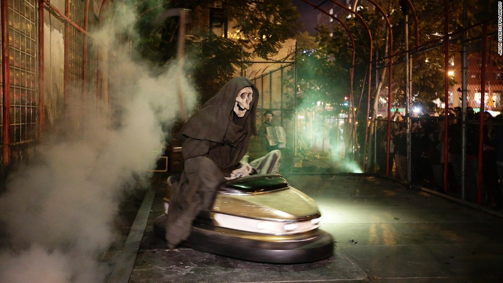 "Banksy's art exhibit ""Grim Reaper Bumper Car"" sits on New York's Lower East Side in October 2013. The famously anonymous artist, whose paintings regularly go for six figures at auction houses around the world, said he was on a ""residency on the streets of New York."""