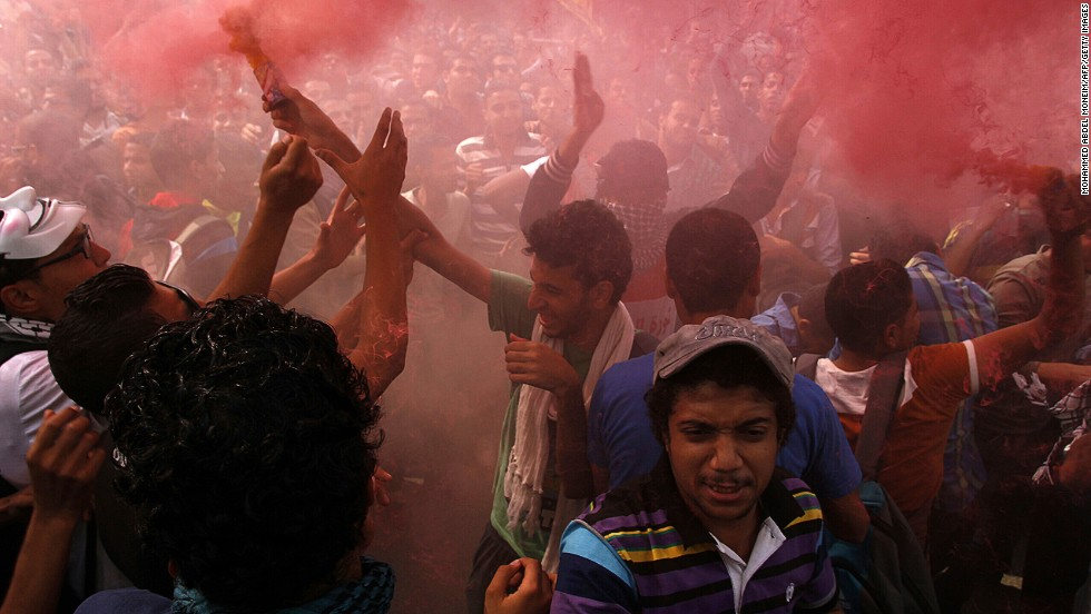 "OCTOBER 29 - CAIRO, EGYPT: Student supporters of ousted president Mohamed Morsy and the Muslim Brotherhood light up a flare as they demonstrate outside al-Azhar university in Cairo on October 28. Since<a href=""http://cnn.com/2013/10/04/world/africa/egypt-clashes/index.html""> Morsy's ouster and detention in July,</a> his supporters have continued to take to the streets."