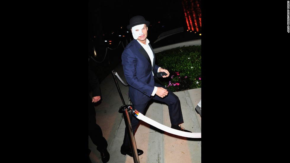 """Ryan Seacrest is such a busy guy, we don't blame him for wanting to disappear for a night as a """"Phantom of the Opera."""""""