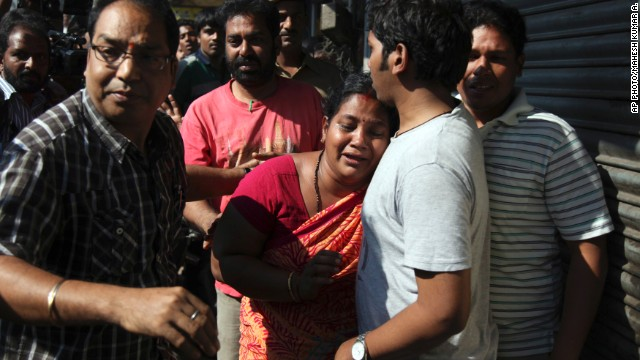 Relatives of passengers on board a crashed bus gather outside the offices of a the bus operator, Hyderabad, Oct. 30, 2013.