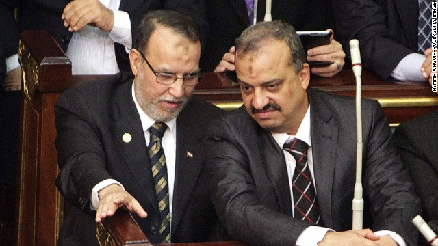 Essam el-Erian (left), and Muslim Brotherhood member Mohamed El-Beltagy talk during a parliament session in Cairo.