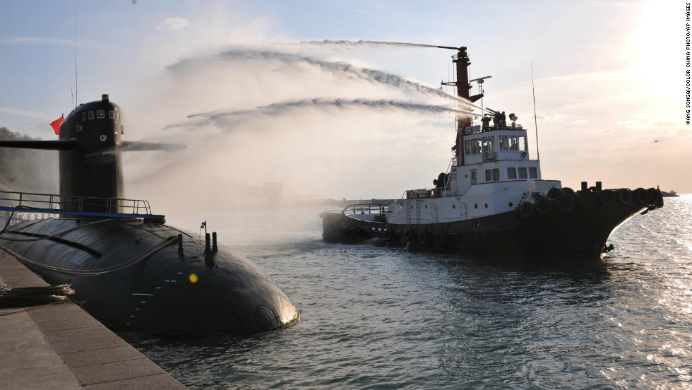 A Chinese navy nuclear submarine takes part in a nuclear safety drill at the Qingdao submarine base in east China's Shandong province on October 26, 2010. The fleet has had a remarkable safety record for more than 40 years and has gained rich experience through rigorous training and drills, its fleet commanders said.