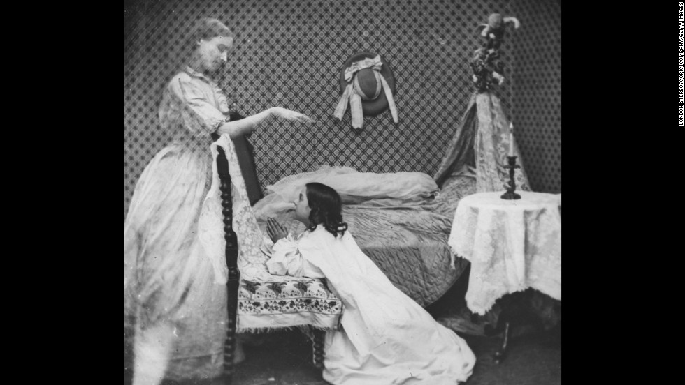 The ghost of a woman appears to a girl at prayer by her bedside.