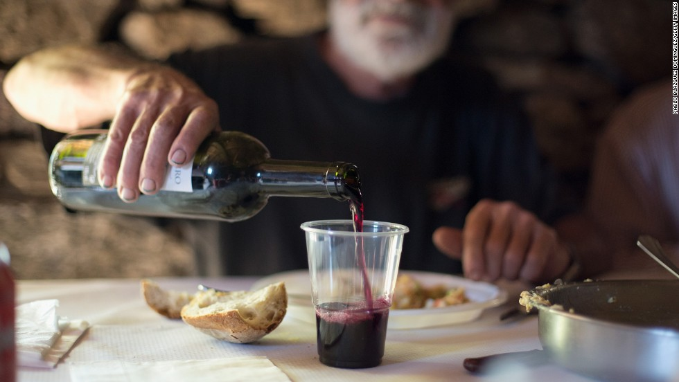 It's not a requirement to drink it on this diet, but if you do drink alcohol, drinking red wine in moderate amounts can be good for your health.  Moderation means one drink for women and  two for men by the way.  Studies show red wine can help protect against heart disease.