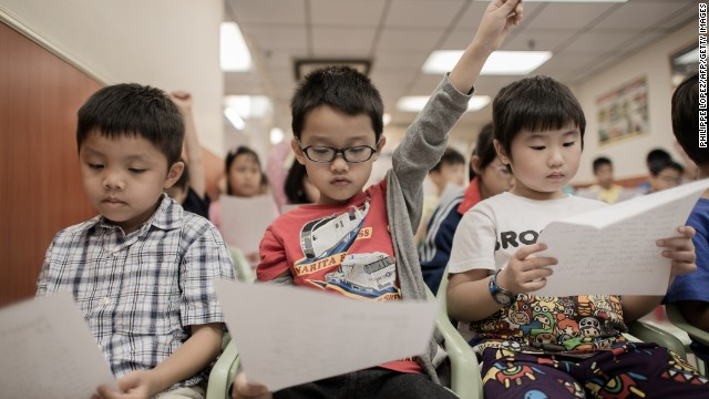 Children learn how to speak English with an American accent at the Nature EQ school in Hong Kong on Sept. 29.