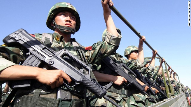 An anti-terrorism force holds exercises in Hami, in northwest China's Xinjiang region in July.