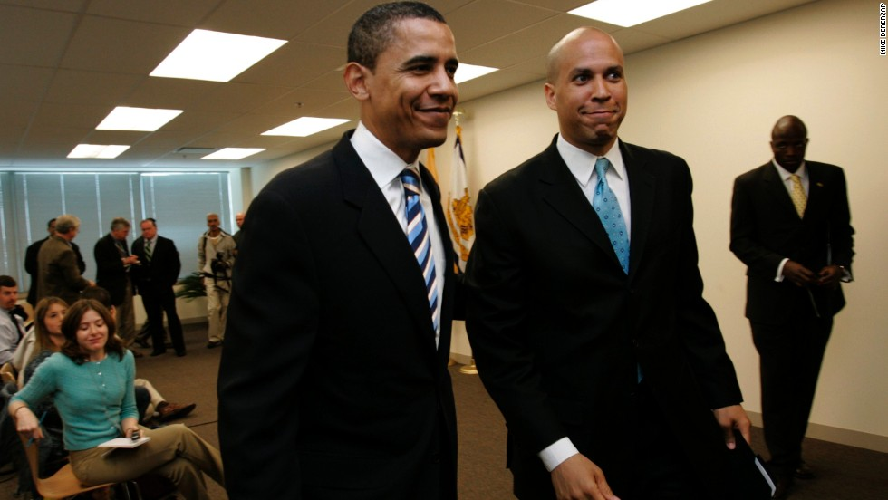Booker walks with then-Sen. Barack Obama after Booker endorsed Obama at a news conference in Teterboro, New Jersey, in May 2007.