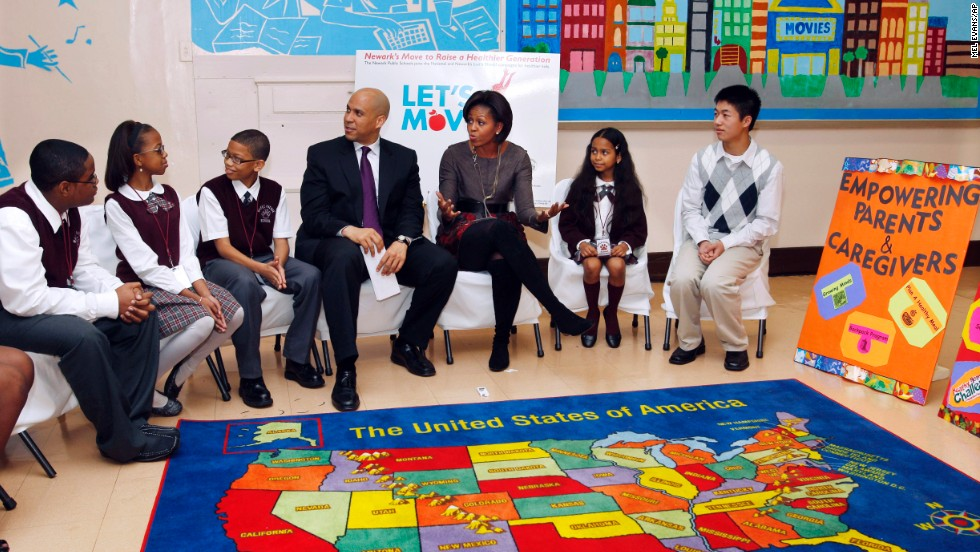 Booker and first lady Michelle Obama sit with children at the Maple Avenue School in Newark in November 2010.
