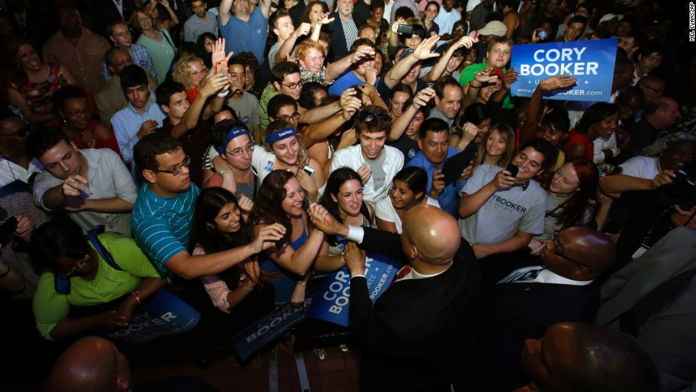 Booker says hello to supporters August 13 in Newark.