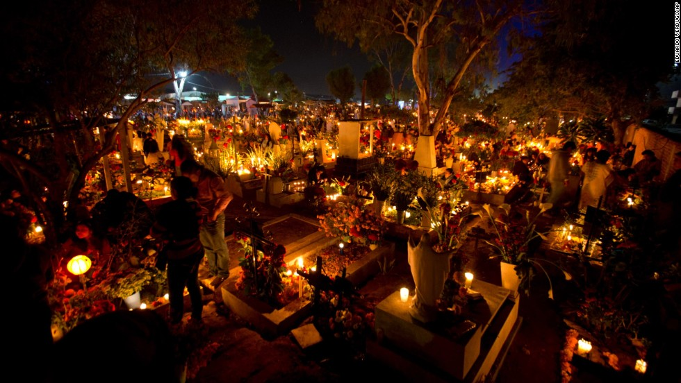 """Some choose to go to the grave site of the loved one instead of building an altar,"" says Mexican-American writer Kathy Cano-Murillo,  owner of Crafty Chica in Phoenix, Arizona. ""Family and friends bring candles which are turned off to symbolize the end of their journey to our world."""