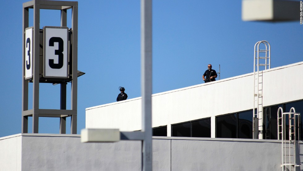 Police officers stand guard atop Terminal 3.