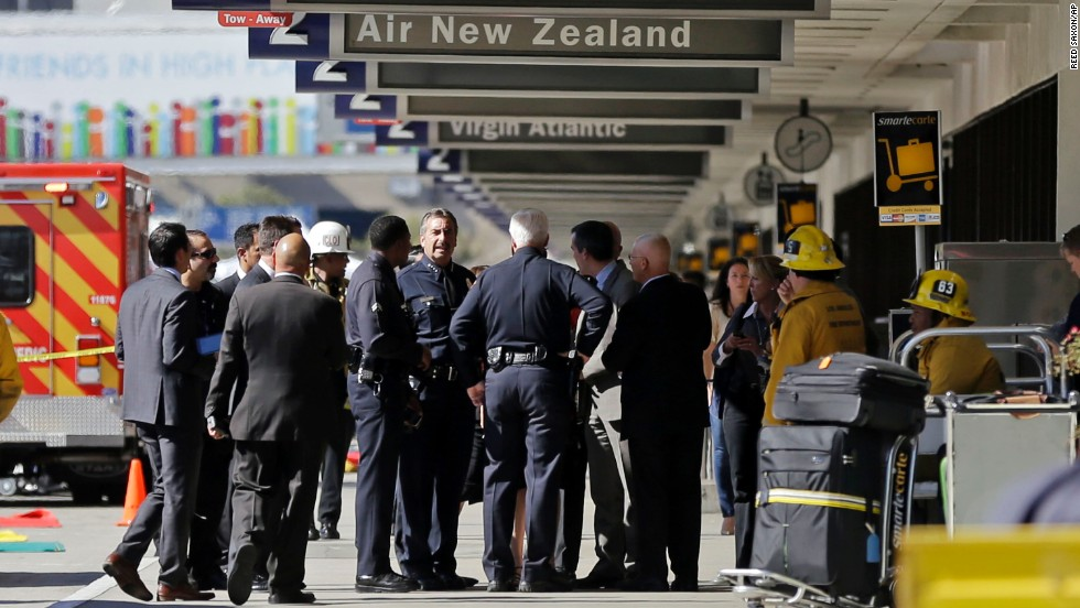 Los Angeles Police Chief Charlie Beck talks with other responders at the airport Friday.