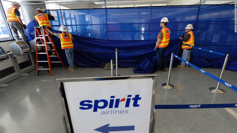 Workers tear down a temporary partition after Terminal 3 was reopened on November 2, a day after a shooting at LAX.