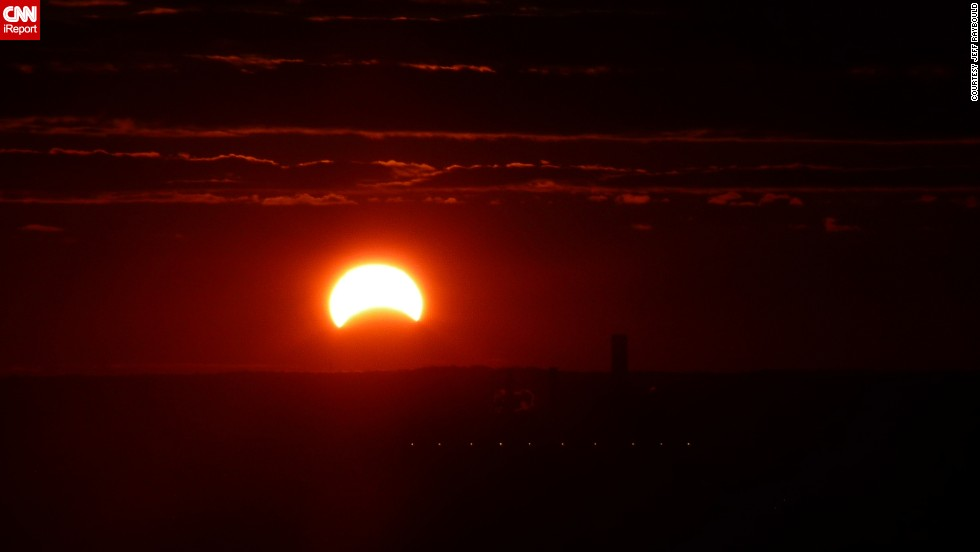 "<a href=""http://ireport.cnn.com/docs/DOC-1056088"">Jeff Raybould </a>took advantage of his apartment view early in the morning and photographed the eclipse. ""I've never seen a solar eclipse. ... I'd love to observe a total eclipse at some point,"" he said."
