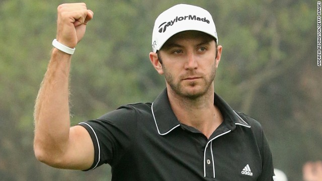 American golfer Dustin Johnson celebrates his crucial chip-in eagle on the 16th hole at the Sheshan International Golf Club.