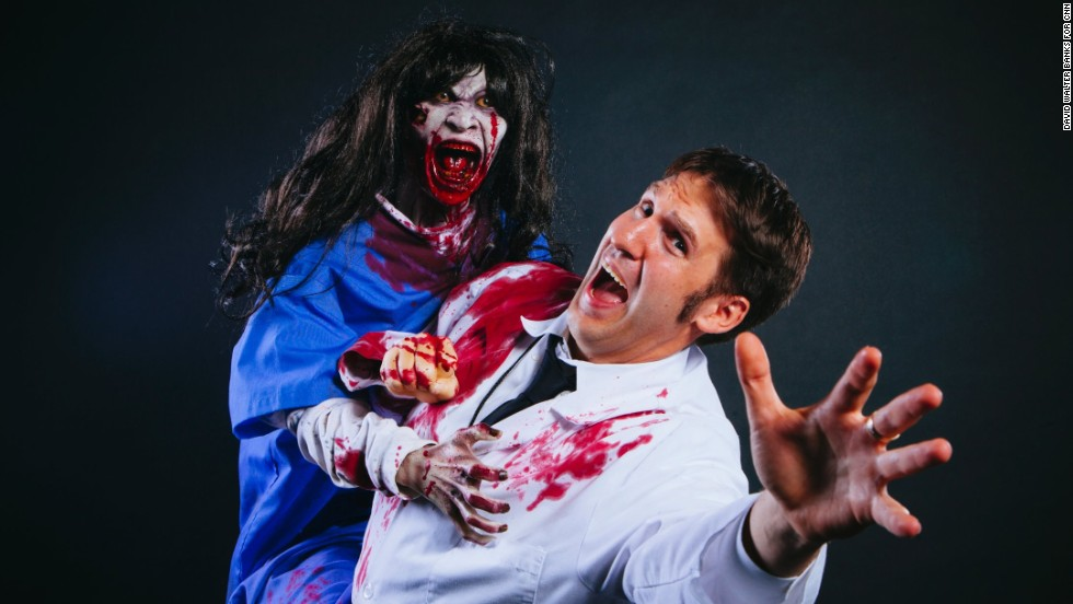 """Doug Schafer poses with the animatronic """"Psych Ward Sally."""""""