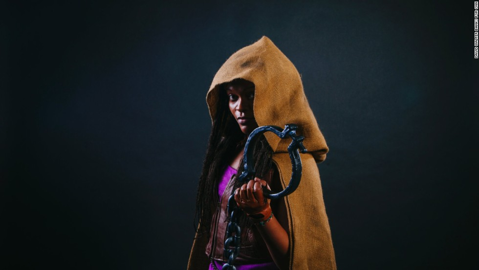 "Jasmine Anderson dressed as Michonne from ""The Walking Dead."""