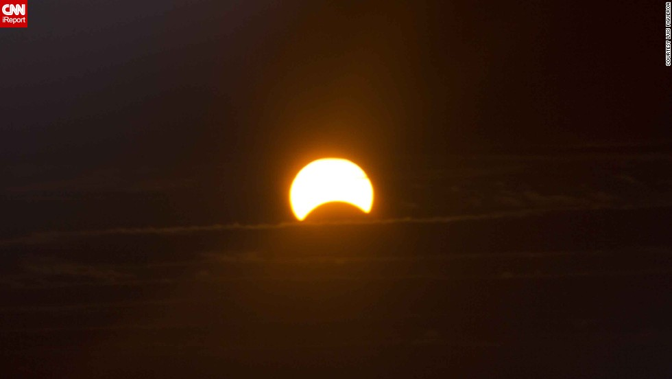"When <a href=""http://ireport.cnn.com/docs/DOC-1056484"">Luis Figueroa</a> tried to photograph the eclipse from his home in New York City, he discovered the sun was too bright. ""So I added my homemade solar filter to [my camera] lens. When I looked through the view finder I was amazed,"" he said."