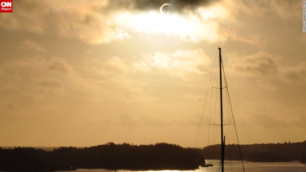 "While vacationing in St. Georges, Bermuda, <a href=""http://ireport.cnn.com/docs/DOC-1056346"">Gareth Seltzer</a> saw the eclipse. ""I looked out the window and found the sun so bright I was not able to see it and knew immediately that something remarkable and rare to witness was underway,"" he said."
