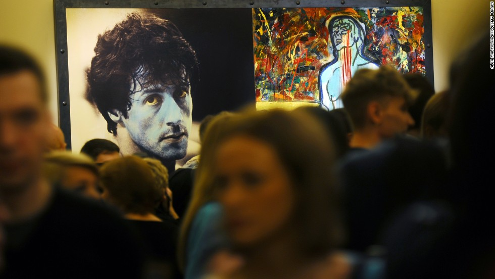 "If you thought his movies were one-dimensional, you may prefer his art work. Sylvester Stallone's exhibition ""Sylvester Stallone. Painting. From 1975 Until Today"" at the Russian Museum in St. Petersburg is now open, running until January 13. It includes paintings such as ""Champion Due,"" shown here, and others in a retrospective of abstract artwork."