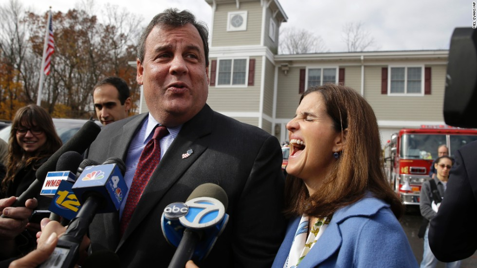 Christie jokes with the media after he and his wife, Mary Pat, voted on Tuesday.