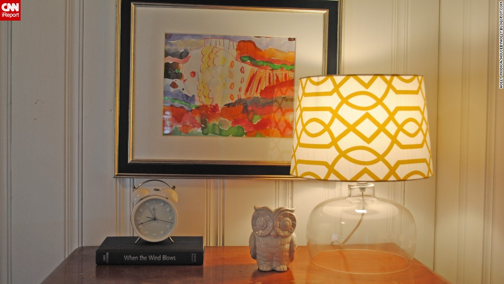 In Modica's room, the addition of the amber on the lamp cover brings out the orange in the painting and adds light in more ways than one.