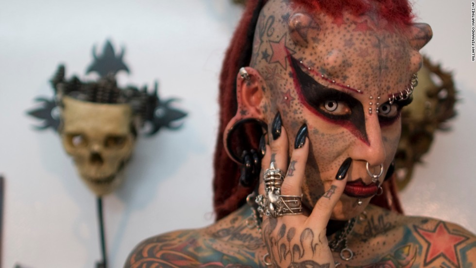 Maria Jose Cristerna poses for pictures during a 2011 news conference in Bogota, Colombia. The Mexican tattoo artist said she started to cover her body in tattoos, piercings, titanium implants and dental fangs to reinvent herself as a vampire, her reaction after suffering domestic violence.