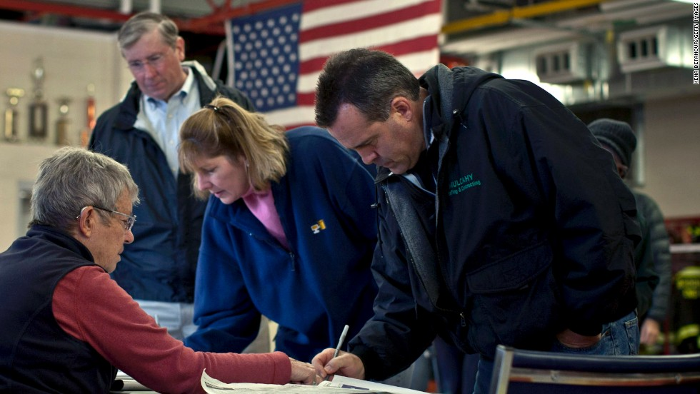 Residents sign in to vote at a polling center set up inside a fire station in Mendham Township.