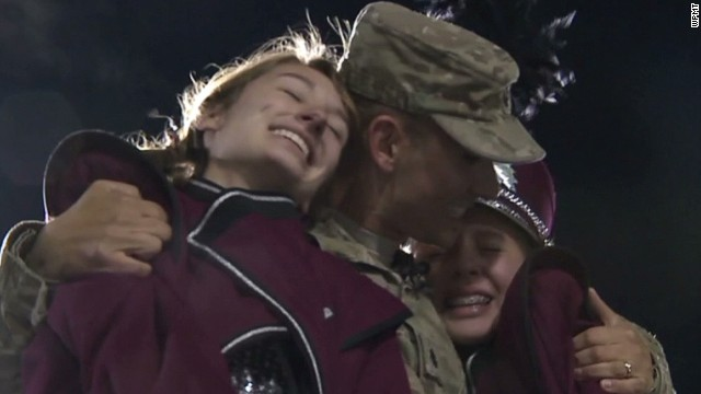 dnt soldier surprises daughters at football game_00010519.jpg