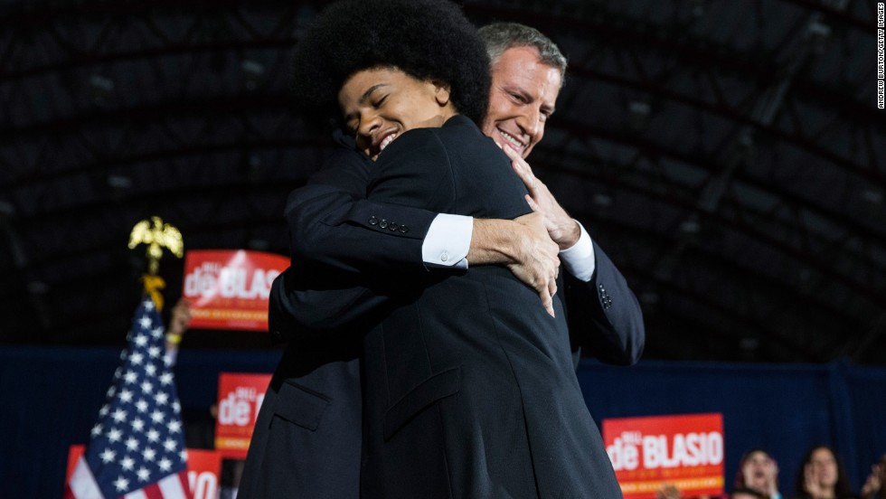 "De Blasio hugs Dante at his election night party. De Blasio's family appeared frequently in his campaign ads, Dante saying in one,<br />""Bill de Blasio will be a mayor for every New Yorker, no matter where they live or what they look like. And I'd say that even if he weren't my dad."""