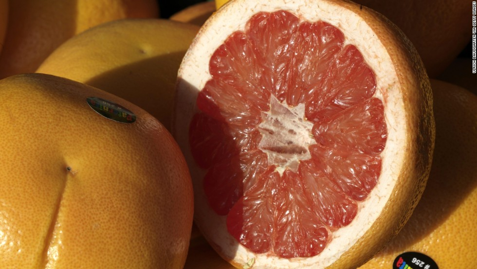 <strong>Grapefruit</strong><br />Water content: 90.5%<br /><br />This juicy, tangy citrus fruit can help lower cholesterol and shrink your waistline, research suggests. In one study, people who ate one grapefruit a day lowered their bad (LDL) cholesterol by 15.5% and their triglycerides by 27%. In another, eating half a grapefruit — roughly 40 calories — before each meal helped dieters lose about three and a half pounds over 12 weeks. Researchers say that compounds in the fruit help fuel fat burn and stabilize blood sugar, therefore helping to reduce cravings.<br />