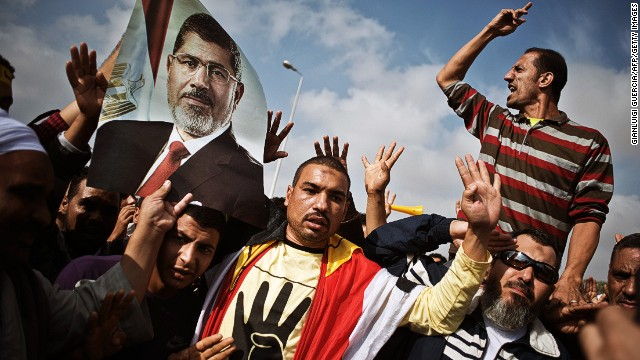 Mohamed Morsy supporters outside the Police Academy where Morsy's trial took place on November 4, 2013 in Cairo.