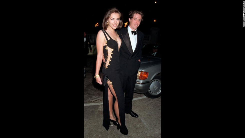 "Actress Elizabeth Hurley set off her career when she wore a revealing  Gianni Versace safety-pin dress to the premiere of her then-boyfriend Hugh Grant's film ""Four Weddings and a Funeral"" in 1994 in London."