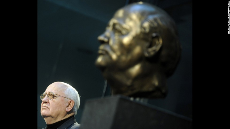 Gorbachev next to a bust of himself created by French artist Serge Mangin after unveiling it to guests in Berlin in 2009.