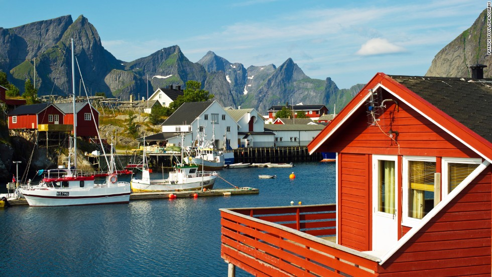 Many of Reine's red fishermen's cabins offer direct access to the Norwegian Sea.