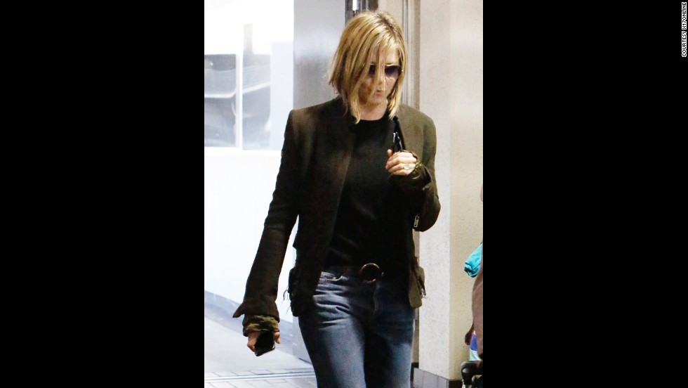 """Jennifer Aniston, who set trends when """"Friends"""" was on the air with her character Rachel, is now following them. The actress didn't go quite as short as many others have, but she did trim her locks down to an """"un-precious"""" bob."""