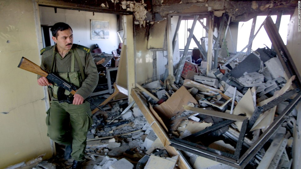A Palestinian security officer inspects damage to Arafat's seaside office in Gaza City on March 10, 2002. Israeli helicopters attacked the compound hours after an Islamic suicide bombing in Jerusalem.